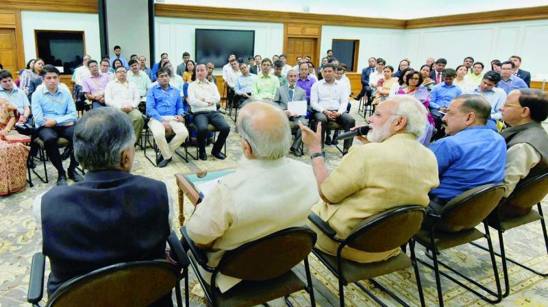 Prime Minister Narendra Modi interacts with the directors and deputy secretaries in New Delhi. (Photo: PTI)