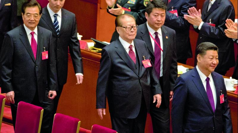 Chinese President Xi Jinping (right) walks ahead of former Presidents Jiang Zemin and Hu Jintao at the opening ceremony of the 19th party congress in Beijing. (Photo: AP)
