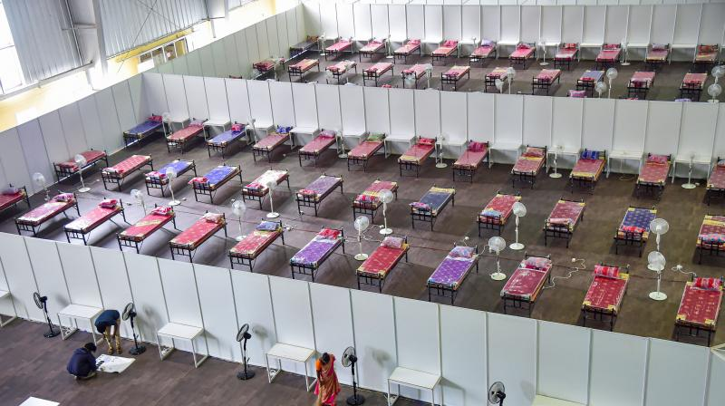 Bed lined at a temporary COVID-19 centre at BIEC in Bengaluru, as coronavirus cases rise across the state. PTI photo
