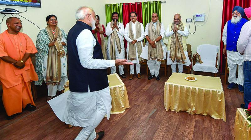 Prime Minister Narendra Modi is greeted by NDA leaders before filing his nomination papers from Varanasi Lok Sabha parliamentary constituency on Friday evening. (Photo: PTI)