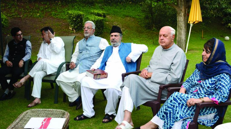 NC president Farooq Abdullah, PDP chief Mehbooba Mufti and leaders of other mainstream parties at an all party meeting in Srinagar on Sunday. 	(Photo: H.U. Naqash)