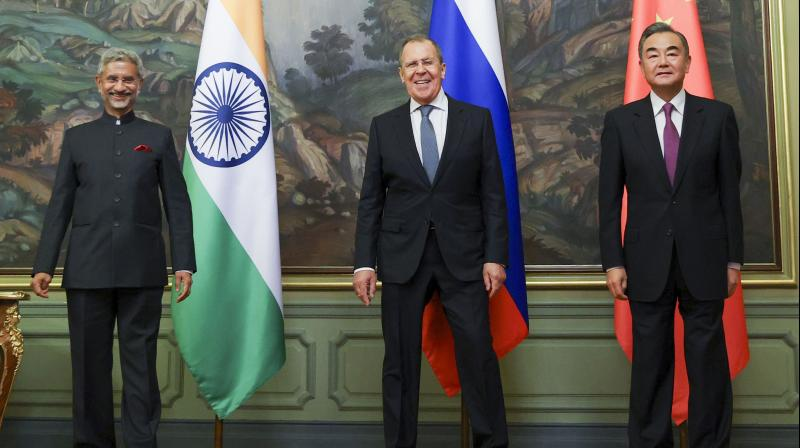 In this photo released by the Russian Foreign Ministry Press Service, the foreign ministers of India, S. Jaishankar, left, Russia, Sergey Lavrov, and China, Wang Yi, pose for a photo on the sidelines of a meeting of Foreign Ministers of Shanghai Cooperation Organisation, Commonwealth of Independent States and Collective Security Treaty Organization Member States in Moscow, Russia. — PTI photo