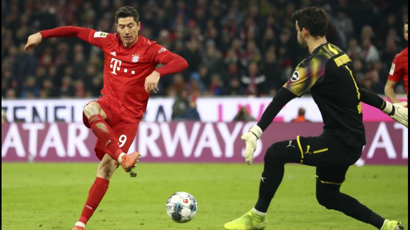 anagerless Bayern Munich thrashed Borussia Dortmund 4-0 in 'Der Klassiker' as Robert Lewandowski continued his phenomenal scoring run with two goals at the Allianz Arena. (Photo:AP)