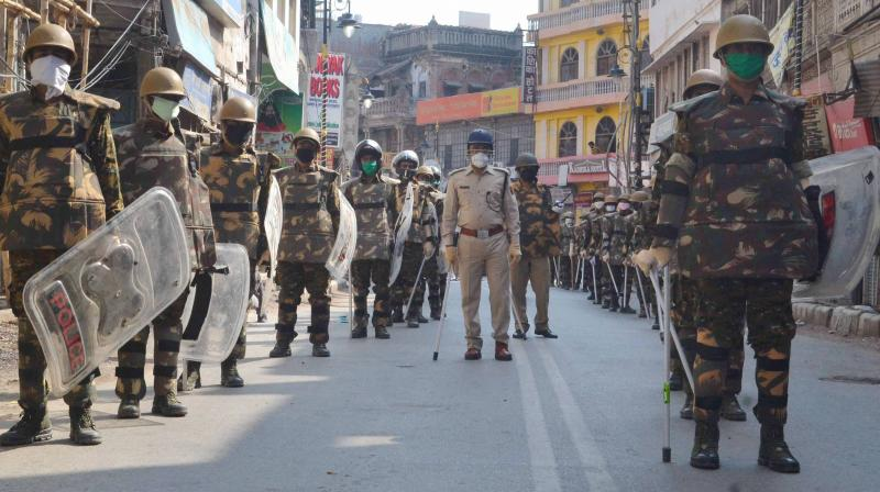 Security personnel patrol a covid19 hot spot area in Varanasi. PTI photo