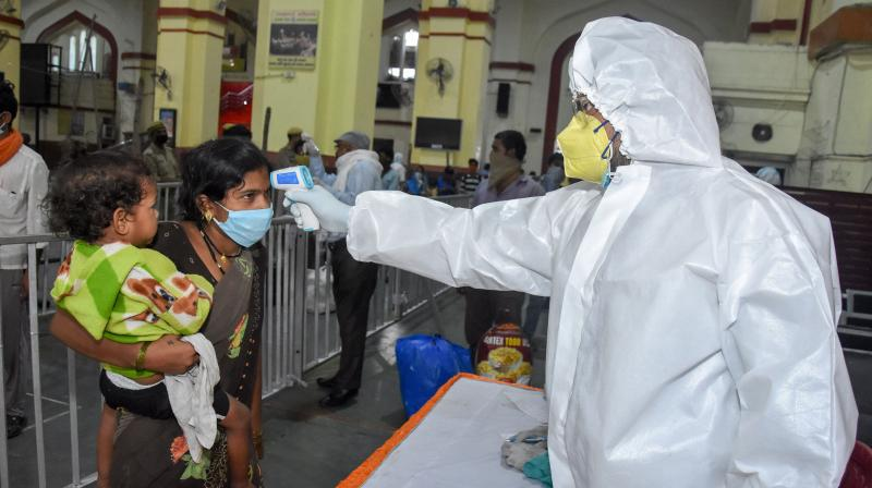 Migrants undergo thermal screening after arriving from Nashik by a special train at Charbagh railway station, during the ongoing COVID-19 lockdown, in Lucknow. PTI photo