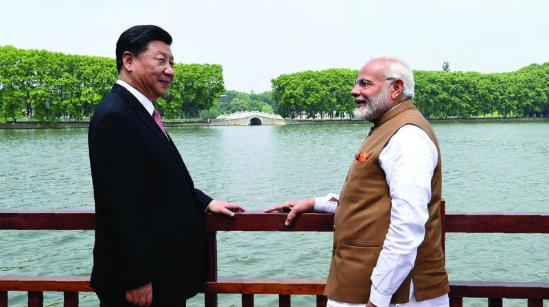 Prime Minister Narendra Modi and Chinese President Xi Jinping agreed to step up cultural exchanges by promoting people-to-people links and unleashing the vitality of the two emerging economies. (Photo: AFP | File)