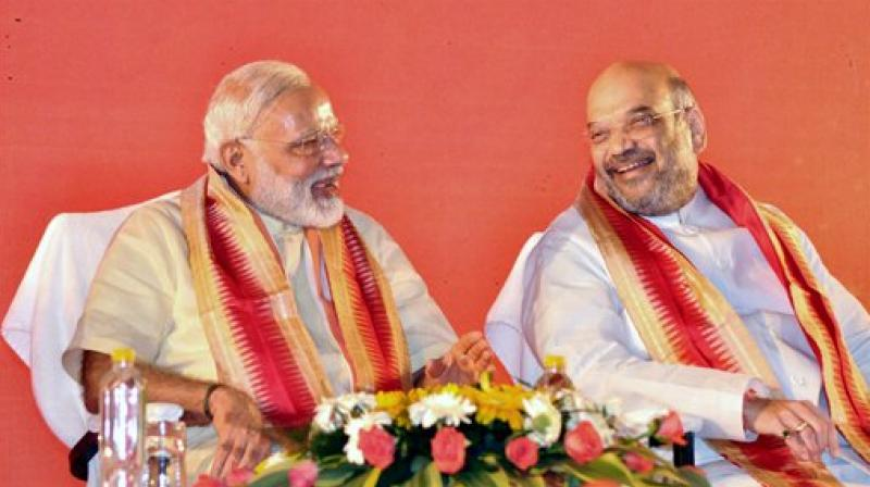 Prime Minister Narendra Modi with part president Amit Shah at BJP's National executive meet in Bhubaneswar on Saturday. (Photo: AP)