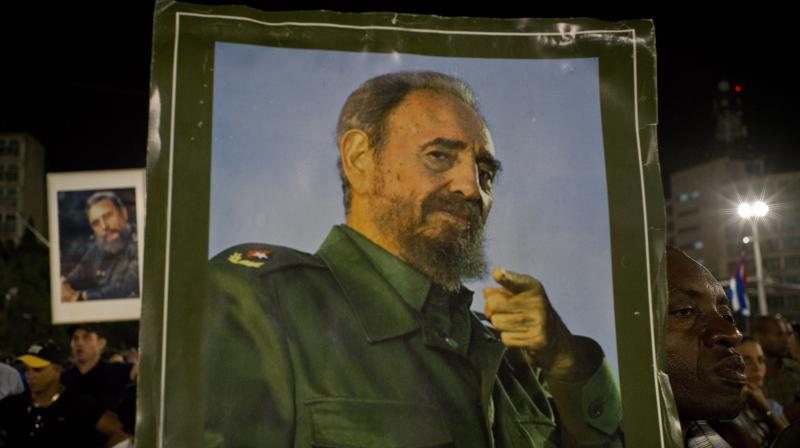 A picture of Fidel Castro is held during a rally honoring the late Cuban leader at the Revolution Plaza in Havana, Cuba. (Photo: AP)