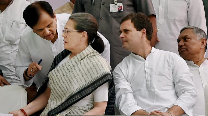 In this file photo dated May 6, 2016, Congress President Sonia Gandhi talks with party leader Ahmed Patel as Vice President Rahul Gandhi and Janardhan Dwivedi look on during the 'Save Democracy' rally at Jantar Mantar in New Delhi. (PTI)