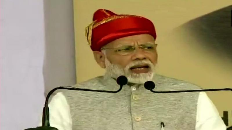 PM Modi launched four-laning of Solapur-Osmanabad section of NH-211, underground sewerage system and three sewage treatment plants and laid the foundation stone of 30,000 houses under Pradhan Mantri Awas Yojana. (Photo: ANI | Twitter)