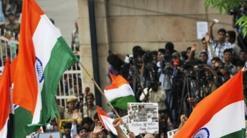 2b856de5413 Protests break out in Noida after Chinese national  tears  Indian ...