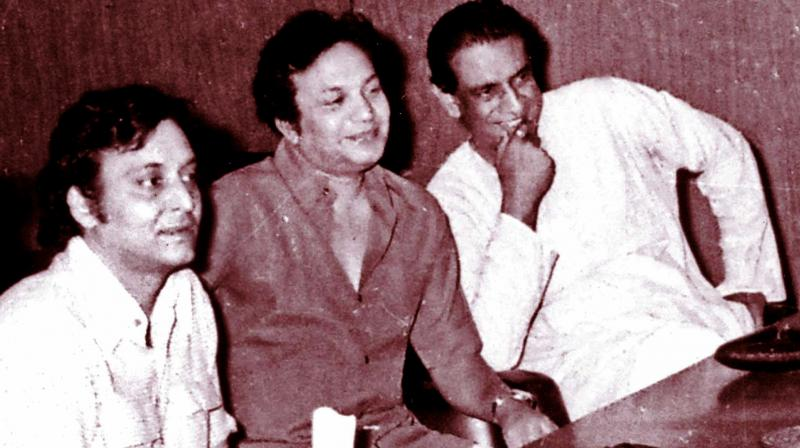 Actors Soumitra Chatterjee (left) and Uttam Kumar (centre) with director Satyajit Ray