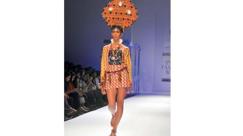 A model displays an outfit by designer Anupama Dayal who worked with four Naga tribes for her collection.