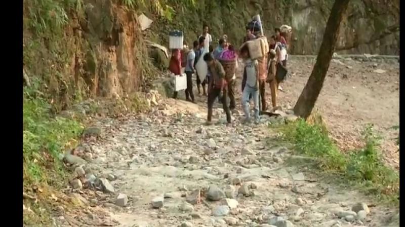 Three polling teams, after trekking for almost three hours, reached their designated polling stations situated approximately 3000 feet above ground level to conduct elections in Buxa Fort on Wednesday. (Photo: ANI)