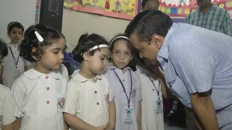 Kejriwal and Sisodia also interacted with students and teachers there.  (Photo: ANI | Twitter)