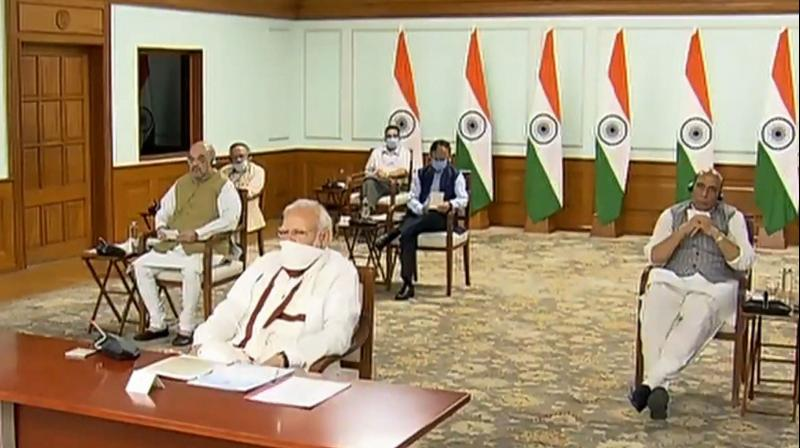 Prime minister Narendra Modi chairs a videoconference with chief ministers on the coronavirus lockdown on Saturday, April 11, 2020. Union mome minister Amit Shah, defence minister Rajnath Singh and others are also seen. (PTI)