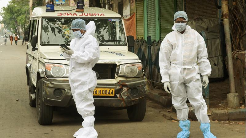 Medics wearing protective suits in Kolkata. PTI photo