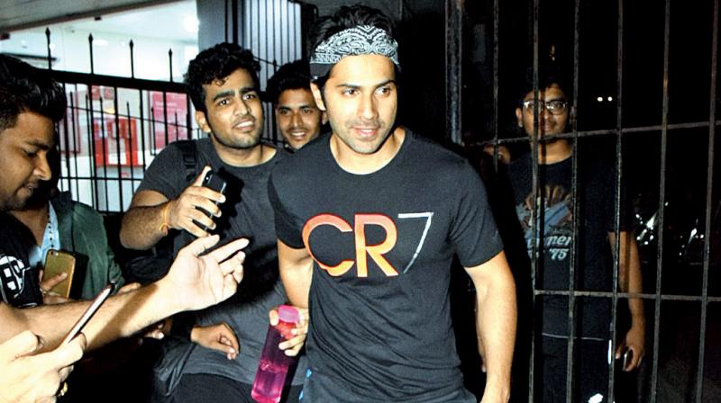 """""""While Varun was taking pictures with some fans, an overzealous one tried to jump into the picture, 'photobombing' him. Varun was upset and asked the fan to step aside."""