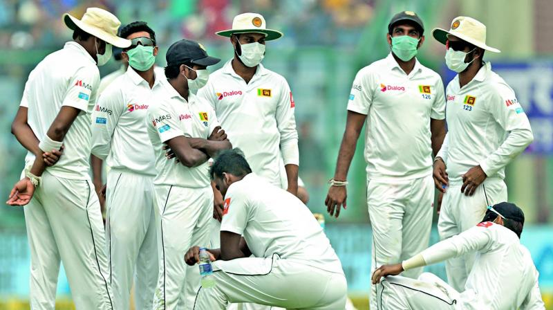 Sri Lankan players wear anti-pollution masks in the second day of the third Test in New Delhi. (Photo: BCCI)