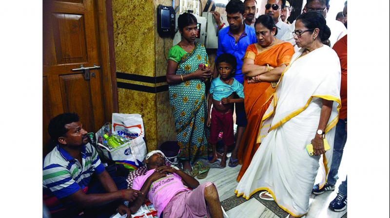 Chief minister Mamata Banerjee talking to patients at N.R.S Hospital in Kolkata on Thursday. (Photo: Asian age)