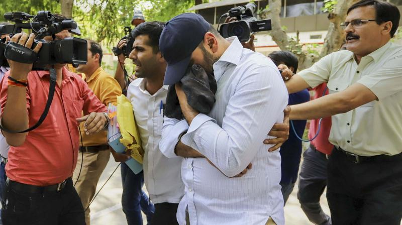 Monty Chadha before being produced in a court in New Delhi on Thursday. (Photo: PTI)