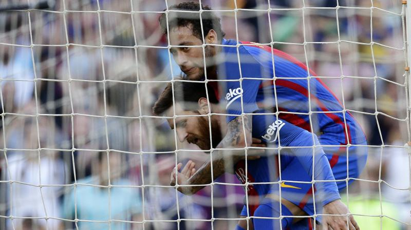 The first of Lionel Messi's two strikes just before half time brought up a century of goals between himself, Luis Suarez and Neymar. (Photo: AP)