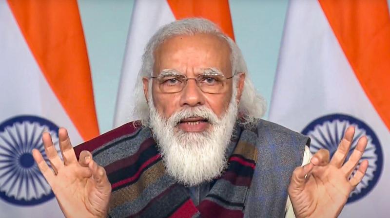 Prime Minister Narendra Modi addresses the farmers of Madhya Pradesh, in New Delhi, Friday, Dec. 18, 2020. (DD/PTI Photo)