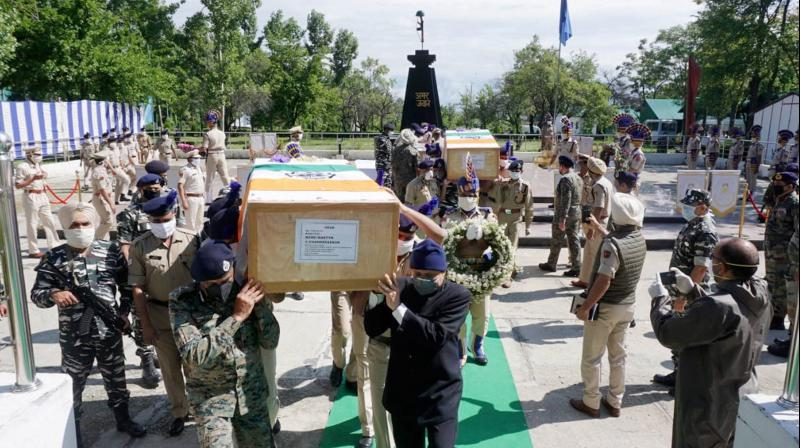 Senior officers carry the coffin of the slain CRPF Constable C Chandra Shekhar, who was killed in a militant attack in Kupwara district, during a wreath laying ceremony at Humhama on the outskirts of Srinagar. PTI Photo