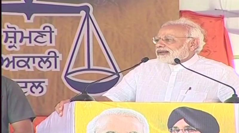 PM Modi said that despite toiling hard, farmers could not think of a comfortable life and that they had to live a life of despair and despondency for decades because of the policies of the Congress-led governments.  (Photo: ANI | Twitter)