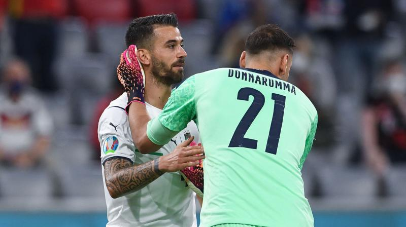 Italy defender Leonardo Spinazzola and goalkeeper Gianluigi Donnarumma interact during the quarterfinal match against Belgium in Munich. The AS Roma defender made a crucial block before suffering an injury which ruled him out of the tournament. (Photo: AFP)