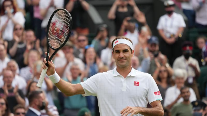 Switzerland's Roger Federer celebrates after winning against Richard Gasquet of France in the Wimbledon Championships in London on Thursday. (Photo: AP)