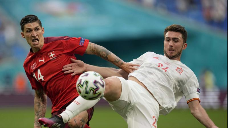 Switzerland's Steven Zuber vies for the ball with Spain's Aymeric Laporte (right) during the quarterfinal match between the two teams in  Russia on Friday. (Photo: AP)