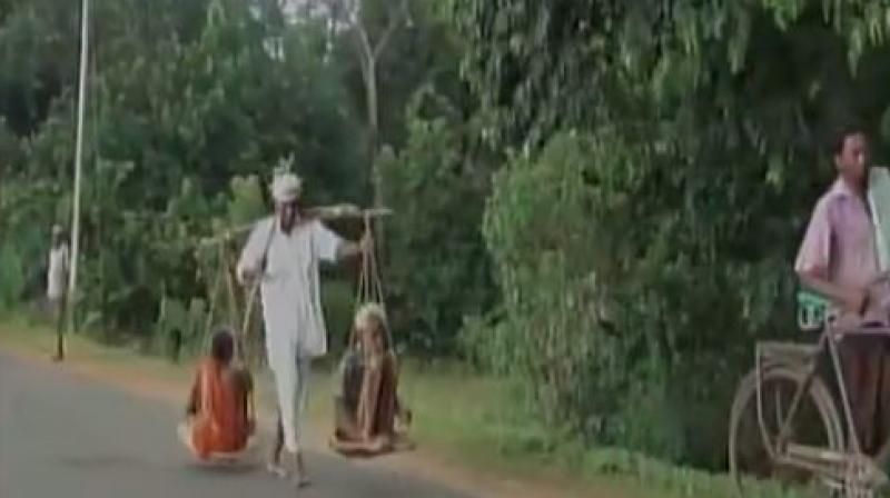 Kartik Singh, who travelled to court seeking justice carrying his parents, said his parents were left alone for 18 days when Moroda Police had lodged a fake FIR against him and locked him up in jail in 2009. (Photo: Twitter   ANI)