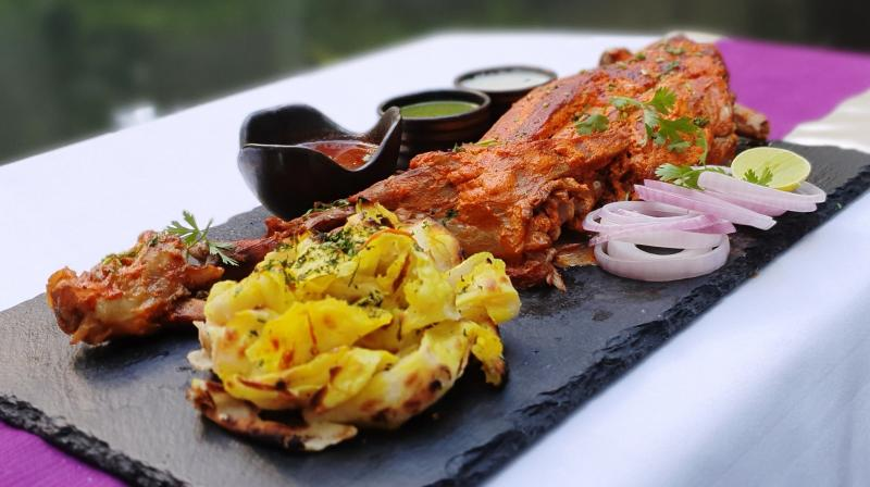 Serve with laccha onion, lemon wedges and green chilli. (Photo: Conrad, Pune)