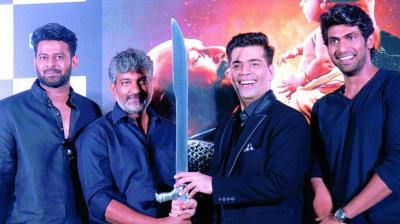 Team Baahubali present Karan with the sword that was used by Katappa in the movie!