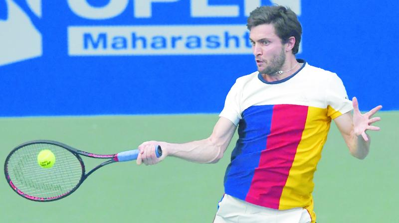 France's Gilles Simon returns to Marin Cilic of Croatia in their Tata Open semi-final at the Balewadi Sports Complex in Pune on Friday. Simon won 1-6, 6-3, 6-2. (Photo: AFP)