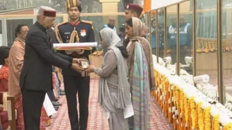 The award was received by Corporal Nirala's wife Sushmanand and his mother Malti Devi at the majestic Rajpath during the 69th Republic Day. (Photo: ANI)