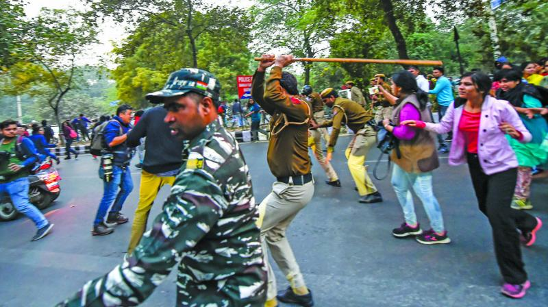 Police lathicharges JNU students during their march from the University  campus to Rashtrapati Bhavan to 'save public education' in New Delhi, Monday. (Photo: PTI)