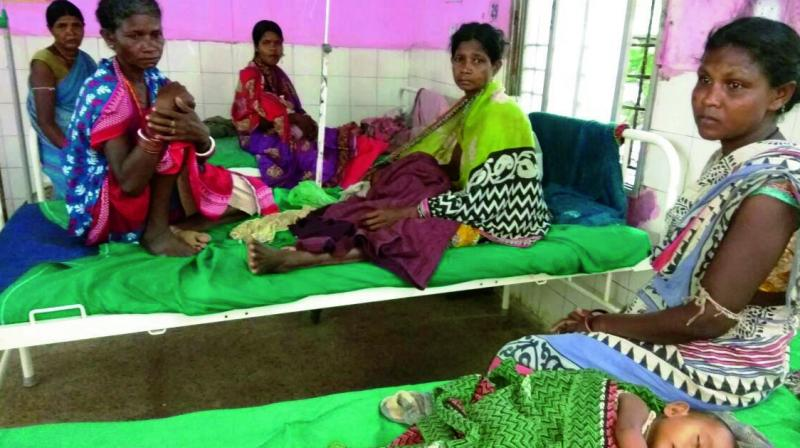 An ailing tribal child underoes treatment at Malkangiri district hospital.
