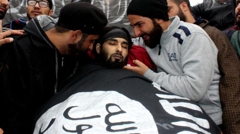 Mughees Ahmed Mir's body was wrapped in an ISIS flag at his funeral, which was attended by thousands of mourners. (Photo: HU Naqash)