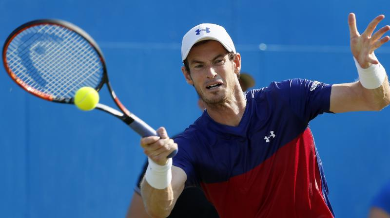Defending champion Andy Murray's indifferent form of late did not prevent him being named top seed for Wimbledon. (Photo:AFP)