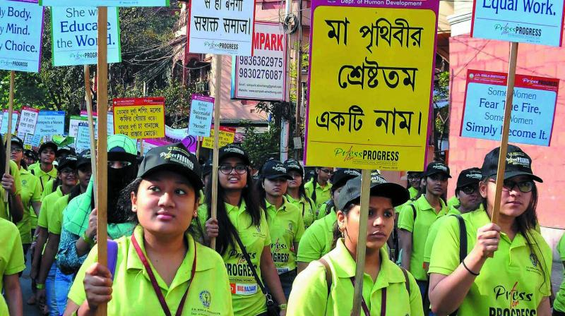 Woman students participate in an awareness rally to mark International Women's Day in Kolkata. (Photo: PTI)