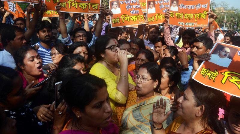 State BJP Mahila Morcha president Locket Chatterjee blows a sankh during their protest rally on Thursday against the miscreants who had defaced the bust of Syama Prasad Mookerjee at Keoratola in Kolkata. (Photo: Asian Age)