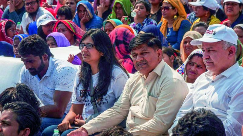 Wrestler Yogeshwar Dutt, Delhi Commission of Women chairperson Swati Jaihind and deputy chief minister Manish Sisodia during Rape Roko, an event to create public awareness against a rise in rapes, at Central Park in New Delhi. (Photo: PTI )