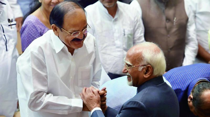 Outgoing vice-president Hamid Ansari is greeted by vice-president-elect M. Venkaiah Naidu during his farewell function at Parliament House in New Delhi. (Photo: PTI)