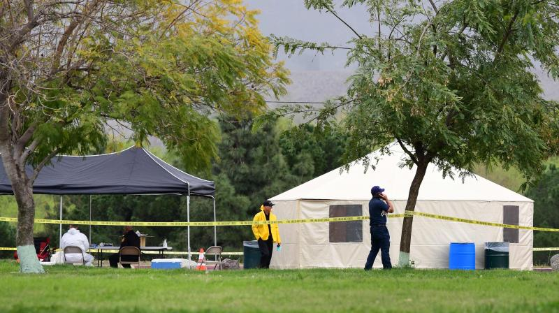 Medical personnel stand outside a tent for coronavirus (COVID-19) testing in Hansen Dam Park on March 25, 2020 in Pacoima, California. (Photo | AFP)