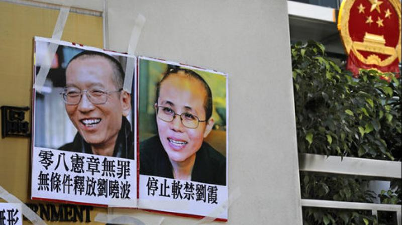 Portrait of jailed Chinese Nobel Peace laureate Liu Xiaobo and his detained wife Liu Xia at a demonstration outside the Chinese liaison office in Hong Kong. (Photo: AP)