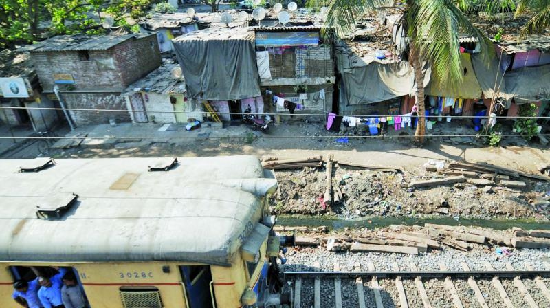 Notices by railways to slum/shanties at Andheri, GTB Nagar and King Circle.