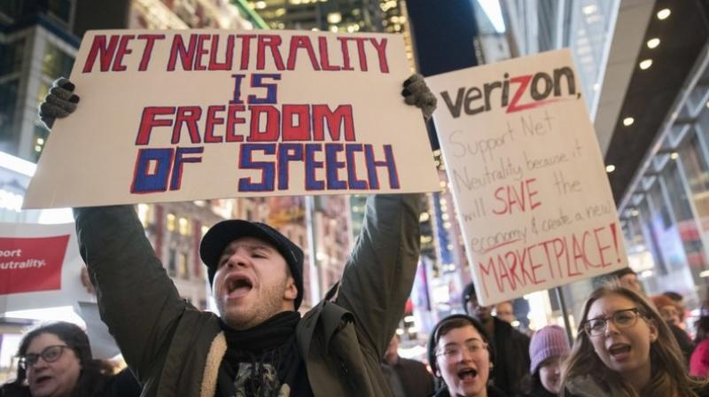 Demonstrators rally in support of net neutrality outside a Verizon store in New York. Any changes are likely to happen slowly, and companies will try to make sure that consumers are on board with the moves, experts say. (AP Photo/Mary Altaffer, File)