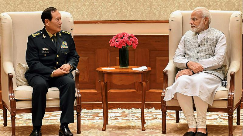 Prime Minister Narendra Modi and Defence Minister of China, General Wei Fenghe during a meeting in New Delhi on Tuesday, August 21, 2018. (Photo: PTI)